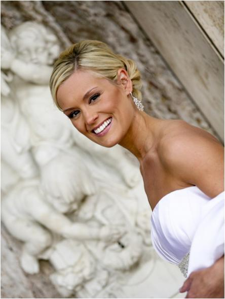 Gorgeous bride in white strapless wedding dress with natural look and chignon