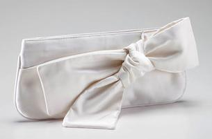 Ivory silk satin clutch with large bow detail
