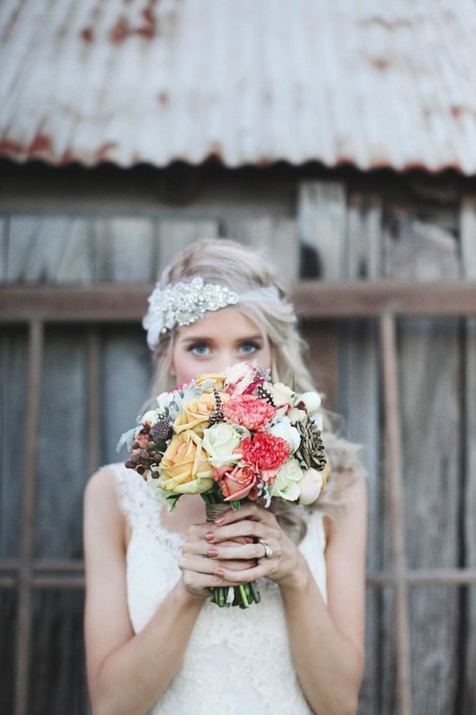 Bride-wears-beaded-wedding-bandeau-holds-romantic-bouquet.full