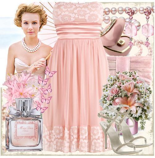 photo of Light pink, flowers, and butterflies bring a whimsical feel to any wedding