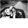 Black-n-white-rock-n-roll-bride-and-groom-in-wedding-car.square