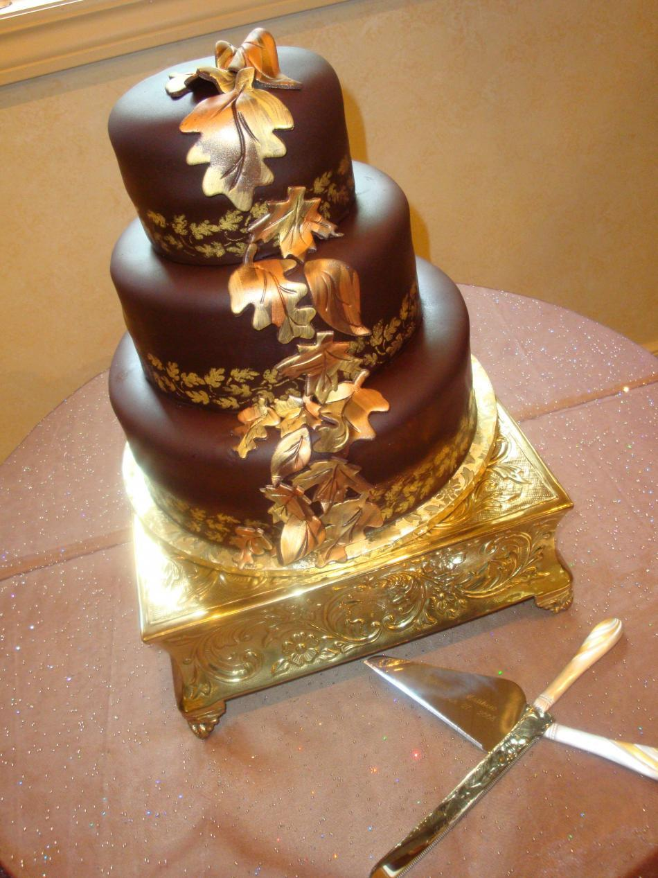 Wedding cake- rolled chocolate fondant, hand lustred edible gold leaves
