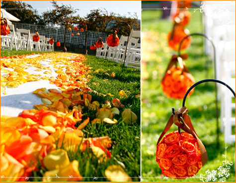 Orange and yellow petals line white aisle
