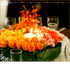Mints-design-citrus-meringue-cupcakes-wedding-theme-green-orange-yellow-flowers-clear-hurricane-glasses-2.square