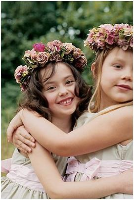 Tiny flower girls with dusty rose and bright pink floral crowns