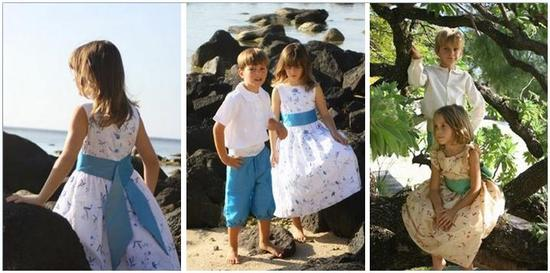 Flower girl and ring bearer pose on beach- white dress with blue sash, blue shorts