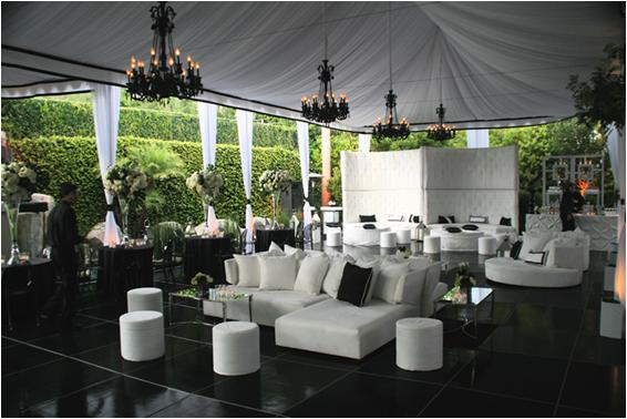 Beautiful white tent, white lounge furniture; black chandeliers ...