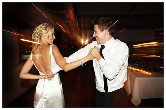 Happy bride and groom dance the night away at wedding reception