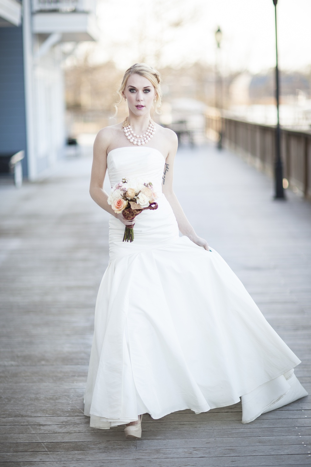 Bride-wears-white-strapless-mermaid-wedding-dress-with-statement-necklace.full