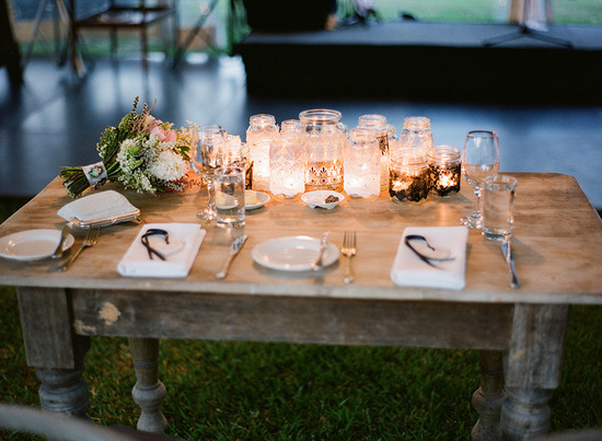 Citronella candles in mason jars for outdoor wedding