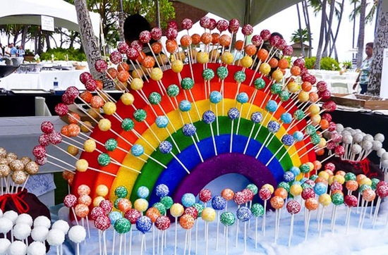 Rainbow wedding cake pop display