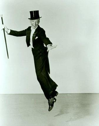 Fred Astaire in tails, tophat, and white gloves