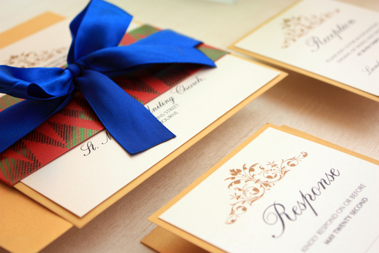 photo of Elegant wedding invitations with a pop of tribal
