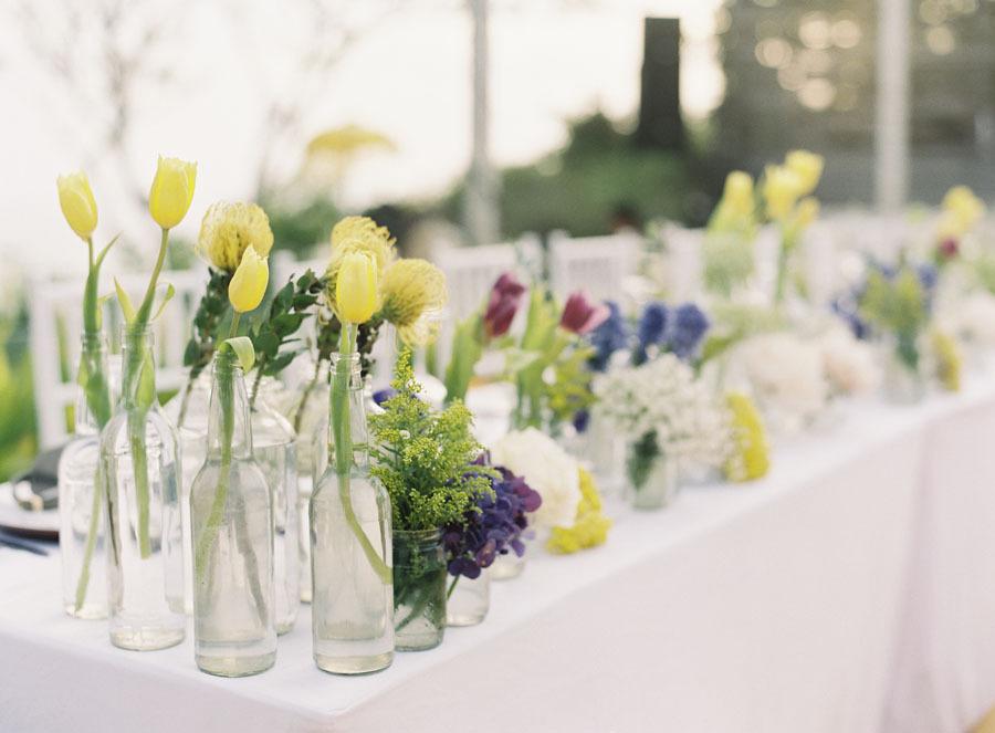 Spring tulips in bottles for wedding reception decor for Wedding reception ideas for spring