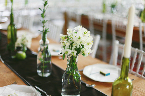 Bottles and Wine Bottles hold wedding flowers