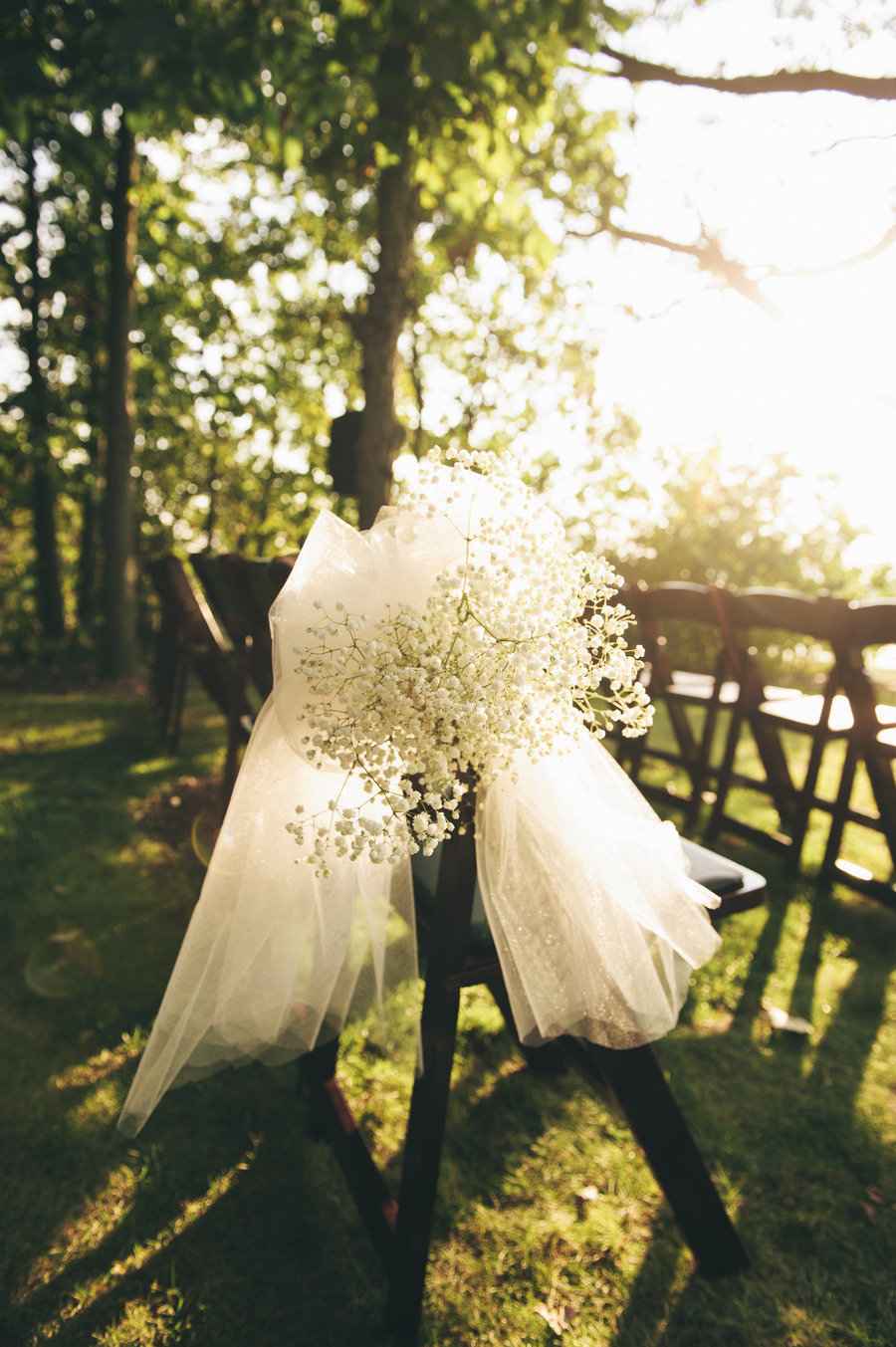 Tulle-bow-with-babys-breath-wedding-ceremony-chair-decor.full