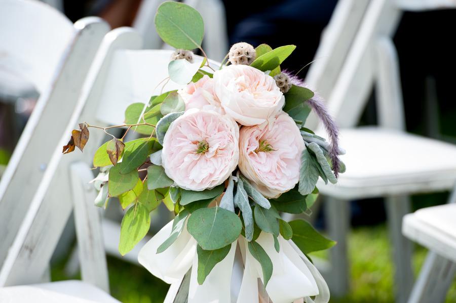 Garden-roses-adorn-white-wedding-ceremony-chairs.full