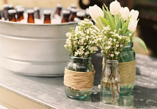 Vintage jars and bottles holding wedding flowers