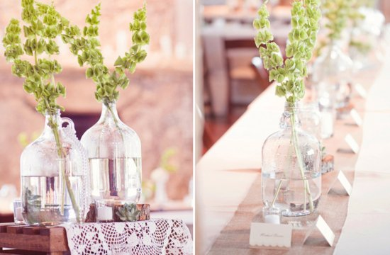 Vintage bottles hold green wedding flowers