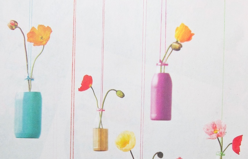 Painted-hanging-bottles-for-wedding-flowers.full