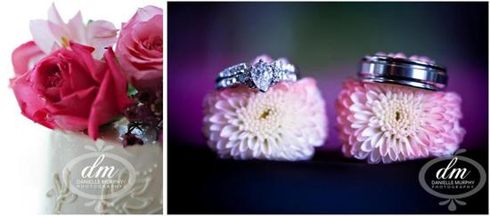Beautiful white cake with pink and fuchsia roses; engagement ring and wedding band on violet flowers