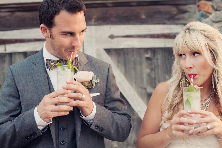 Bride-and-groom-sip-on-signature-drinks.full