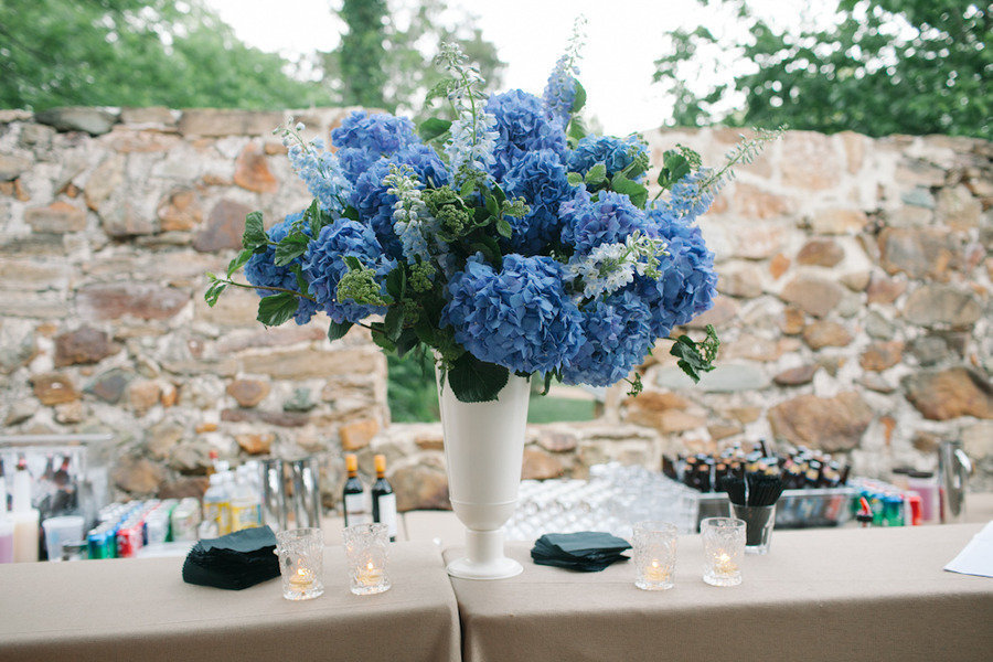 Blue and green hydrangea wedding centerpiece