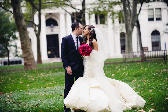Philly bride and groom pose outside wedding venue