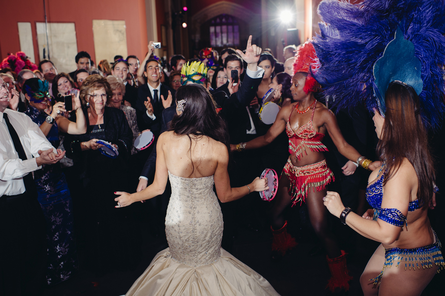 Bride-in-mermaid-wedding-gown-dances-with-entertainment.full