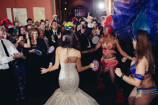 Bride in mermaid wedding gown dances with entertainment