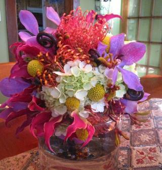Colorful-low-table-centerpiece-bright-pink-purple-white-yellow-orange.full