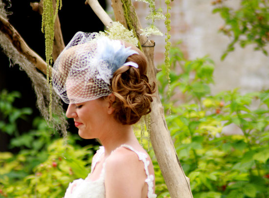 birdcage veil with light blue feather
