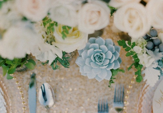 Ivory roses and succulents wedding centerpiece