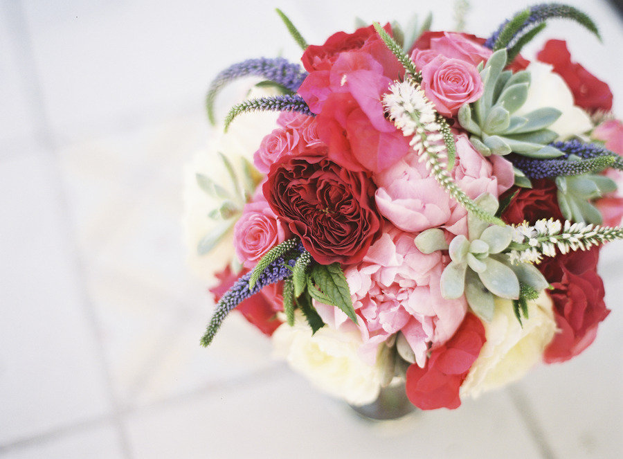 Romantic bridal bouquet with peonies roses succulents