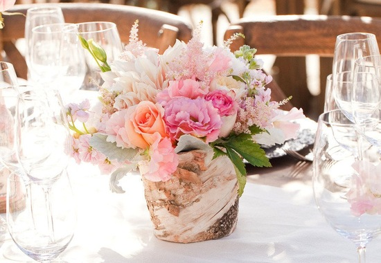 romantic wedding centerpiece in rustic wood vase