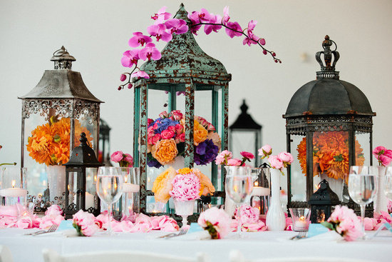 Orange pink spring wedding centerpieces with lanterns