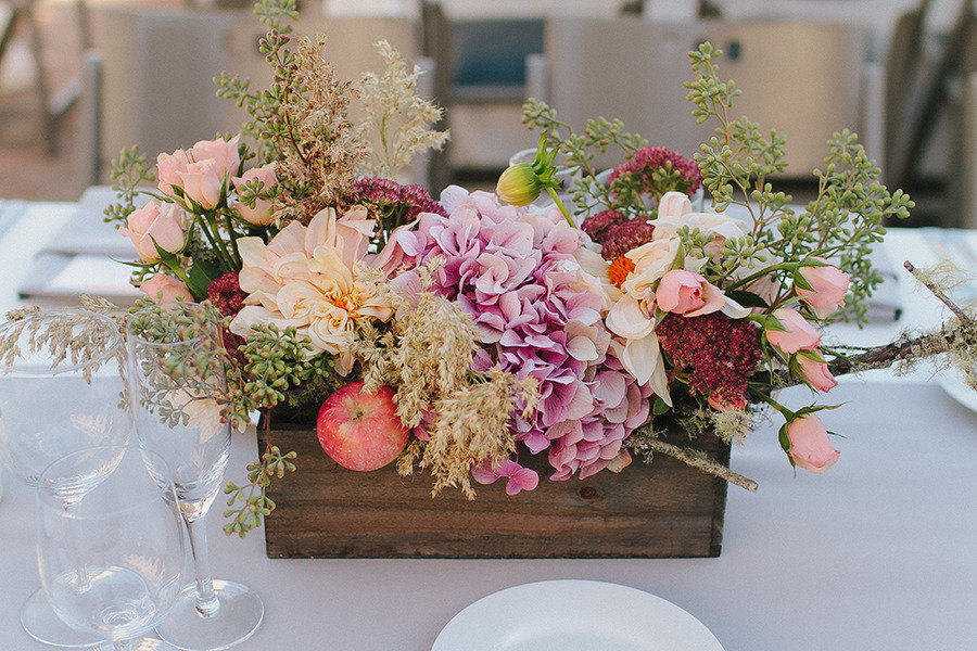 Rustic spring wedding centerpiece in planter onewed