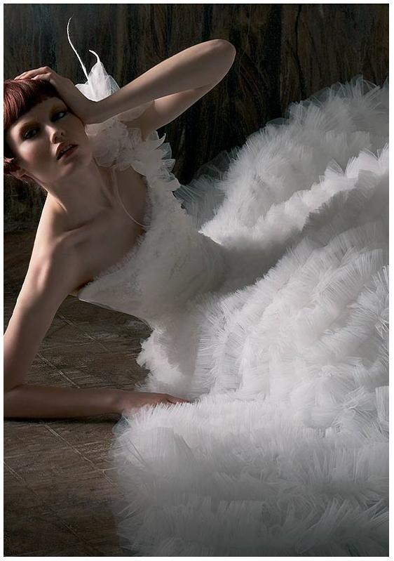 Exotic-asymmetrical-wedding-dresses-white-ruffles-dramatic-tiers.full