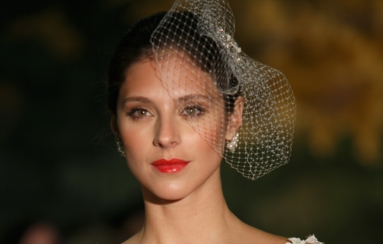 Red glossy lips and birdcage veil at Anne Barge