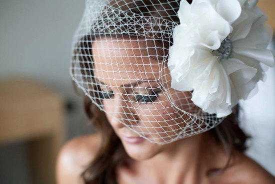 Birdcage wedding veil with large flower