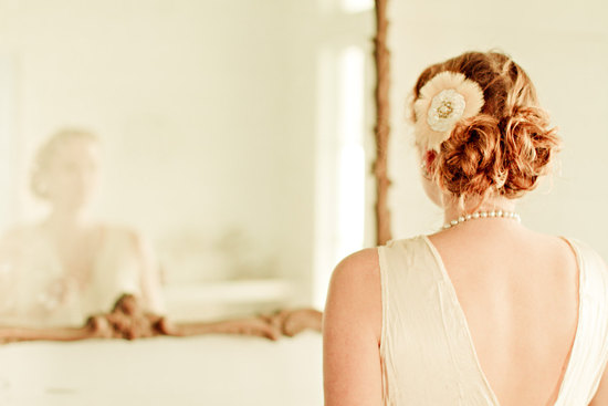 Messy twisted updo with vintage hair flowers blush ivory