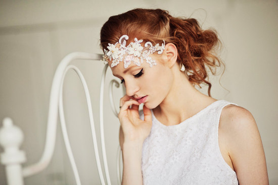 messy bridal updo with floral headpiece