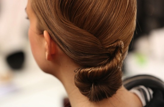 Sleek wedding updo at Elie Saab