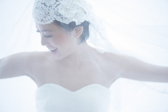 White lace and tulle bridal veil with cap