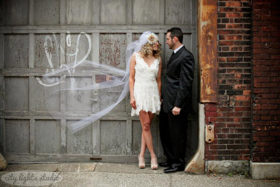 Vintage bride wears ivory lace LWD art deco veil