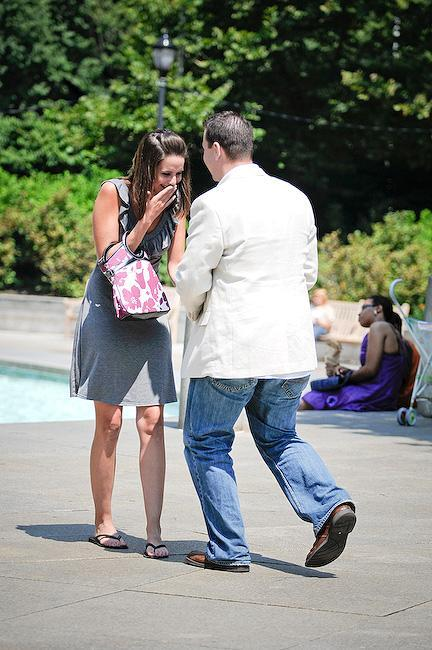 Boyfriend prepares to get down on one knee and pop the question