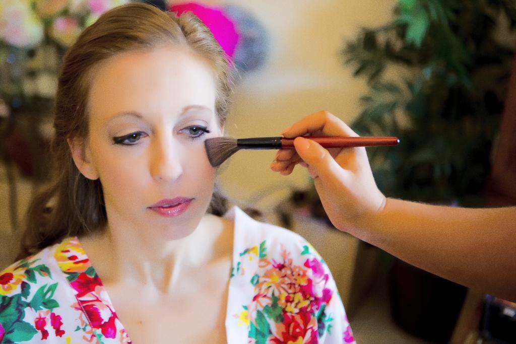 Florida-bride-gets-ready-wearing-bright-floral-kimono.full
