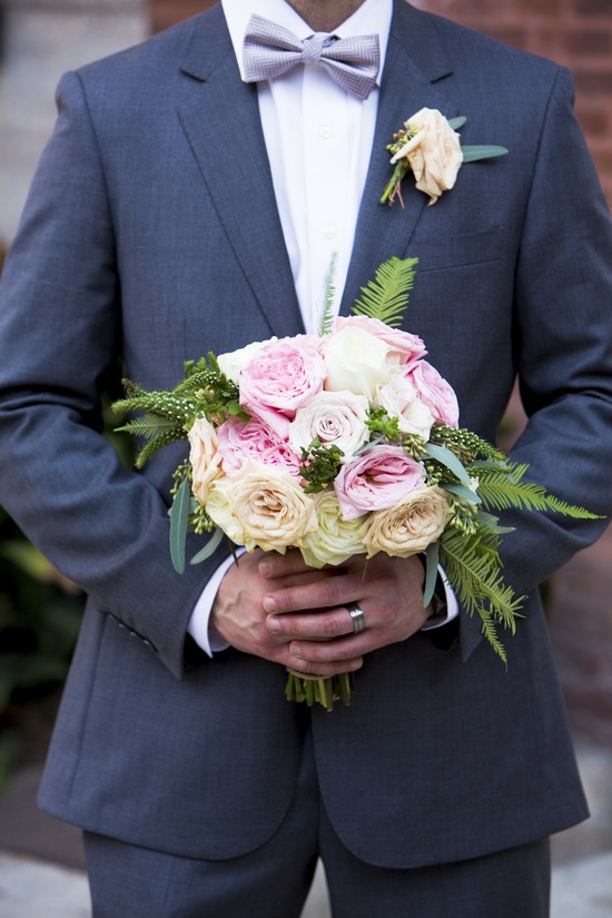 Classic grooms attire charcoal suit pastel peach rose boutonniere