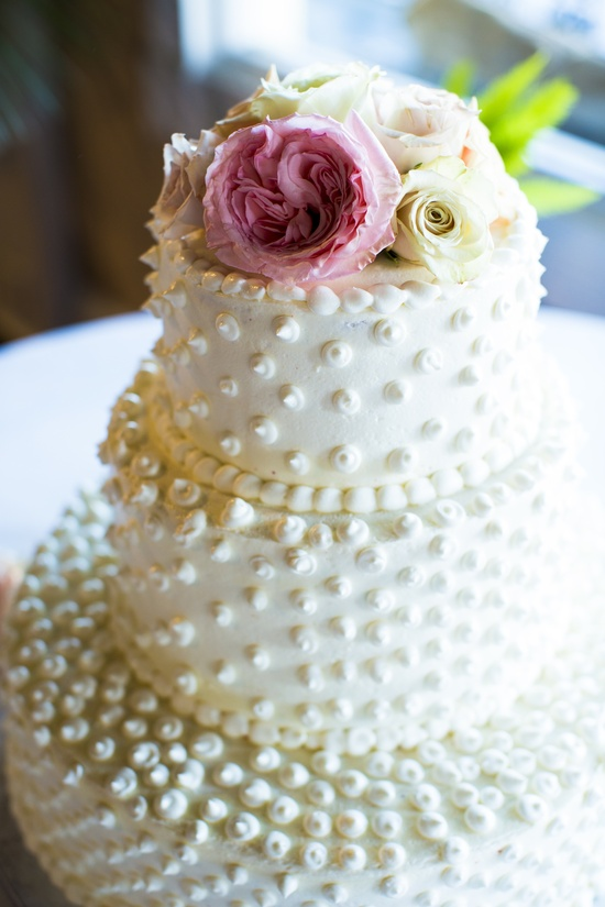 Classic ivory wedding cake with pearl polka dots
