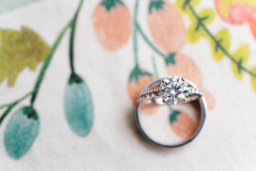 Round diamond engagement ring photographed with band